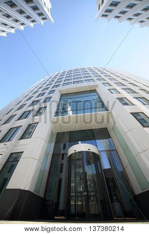 MOSCOW - MAY 20, 2015: Entrance to the building of modern business center Aquamarine, view from the bottom point