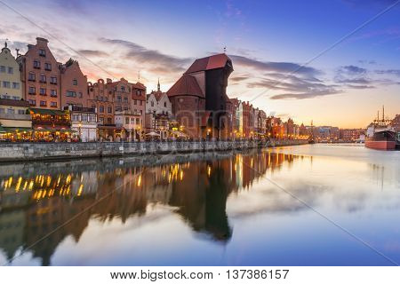 Old town of Gdank with reflection in Motlawa river at sunset, Poland