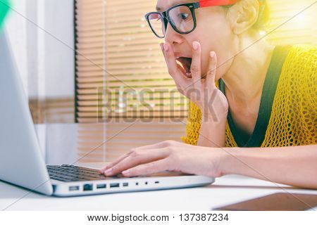 Shocked Woman With Laptop Computer Holding Blank Credit Card, Sitting At Table, Business Background,