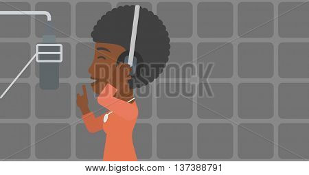 An african-american woman in headphones making a record of her voice in studio vector flat design illustration. Horizontal layout.