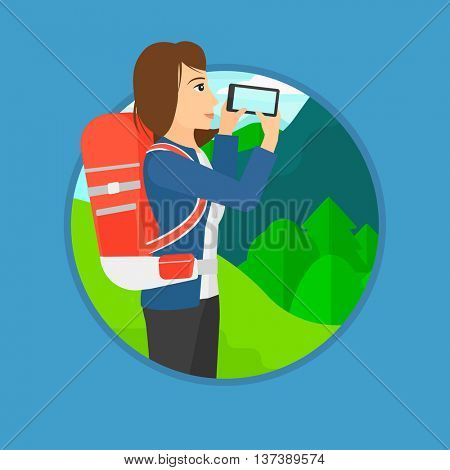 Traveling woman taking photo of landscape with mountains. Young hiking woman with backpack taking photo with her cellphone. Vector flat design illustration in the circle isolated on background.