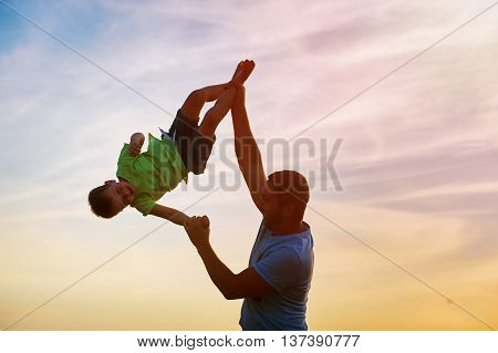 Happy family. Father and son playing outdoors. The concept of father's day.