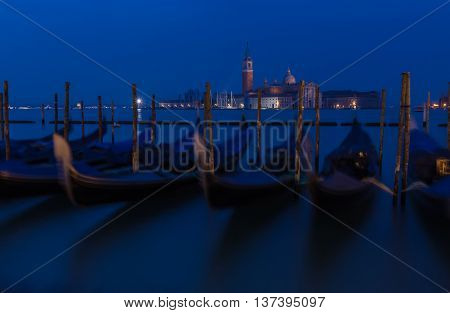 Traditional gondolas with the bell tower of the Saint Giorgio Maggiore Church on background (view from San Marco embankment) - Venice Italy