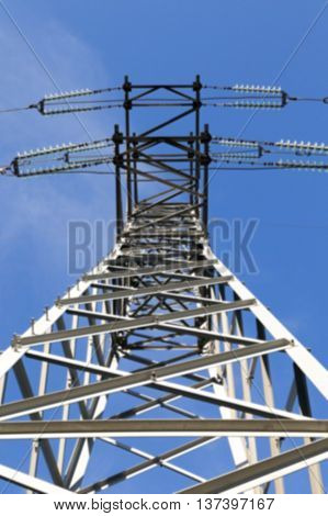 photographed close up, high voltage electric poles, out of focus