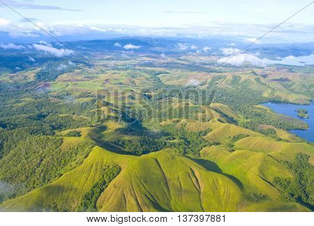 Aerial photo of the coast of New Guinea with jungles and deforestation