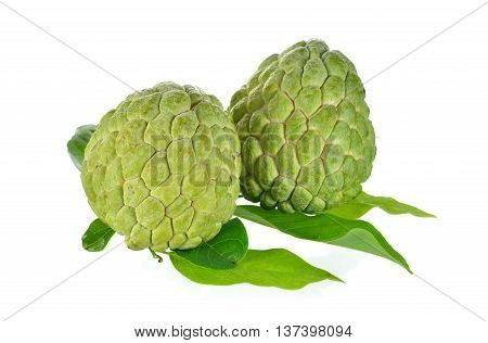raw custard apple with leaves on white background