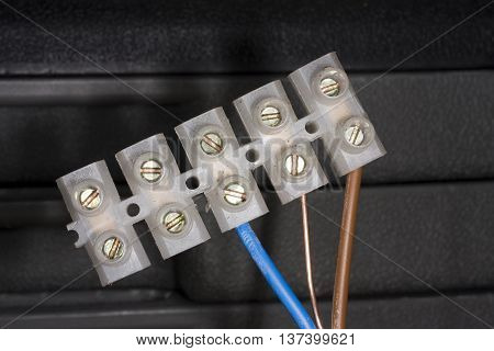 Chocolate bar electrical cable connecter to UK standard.