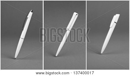 Set of white plastic ballpoint pen on a grey background