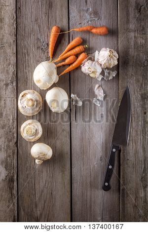 Ingredients for cooking: mushrooms carrots and garlic. Top view