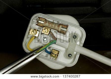 Wiring of UK standard three pin square electric plug.