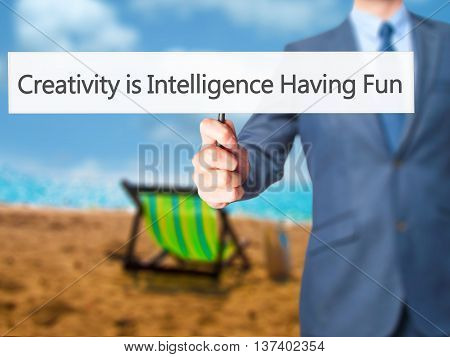 Creativity Is Intelligence Having Fun - Business Man Showing Sign