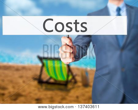 Costs - Business Man Showing Sign