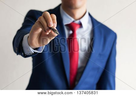 Closeup Of Young Business Man Hand Writing In The Air As Write On Touch Screen