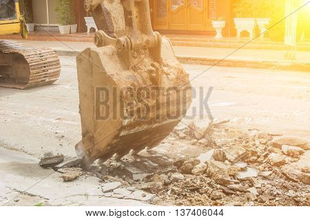 Large excavators Road construction site demolition.backhoe working contractor.Big excavator.
