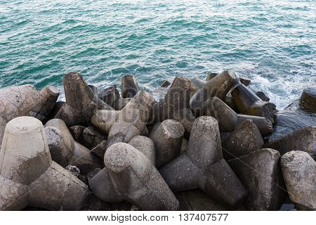 Breakwater on black sea with wave .