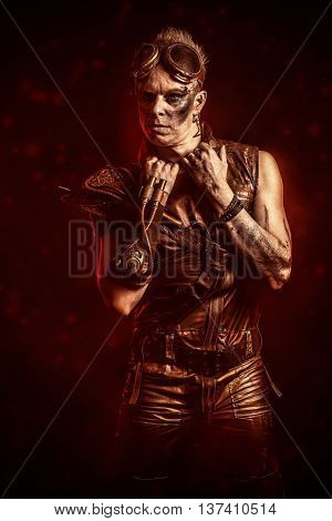 Portrait of a steampunk man with a mechanical devices. Fantasy.