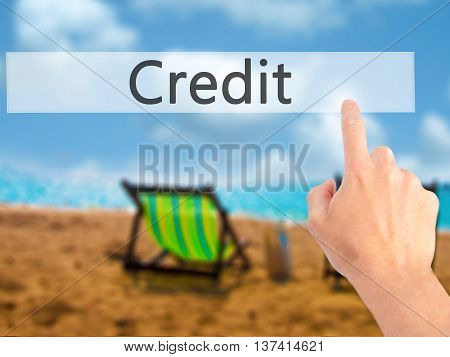Credit - Hand Pressing A Button On Blurred Background Concept On Visual Screen.