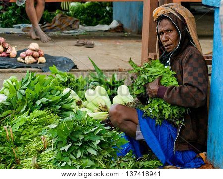 PAPUA PROVINCE INDONESIA -DEC 28: Green vegetable displayed for sale at a local market in Wamena on New Guinea Island Indonesia on December 28 2010.
