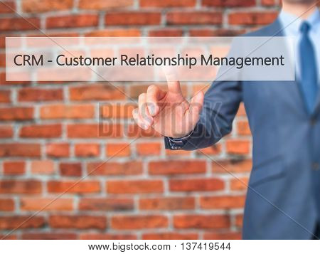 Crm Customer Relationship Management - Businessman Hand Touch  Button On Virtual  Screen Interface