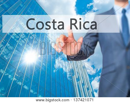 Costa Rica - Businessman Hand Touch  Button On Virtual  Screen Interface