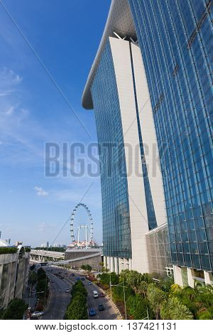 SINGAPORE SINGAPORE - FEBRUARY 17: Daytime view of Marina Bay Sands Building and Singapore Flyer Wheel on February 17 2016 in Singapore.