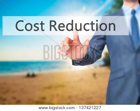 Cost Reduction - Businessman Hand Touch  Button On Virtual  Screen Interface