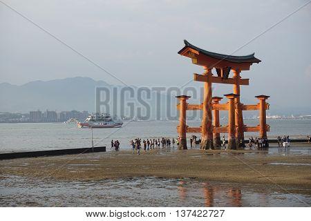 Floating orange shinto shrine of Miyajima (in the Hiroshima region, Japan) on the Itsakushima island during the sunset as a symbol of Japan culture and   religion