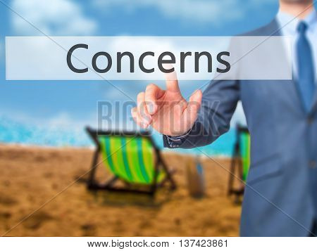 Concerns - Businessman Hand Touch  Button On Virtual  Screen Interface