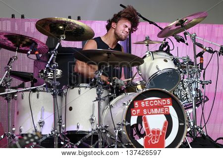 HOLLYWOOD, CA-OCT 24: Ashton Irwin of 5 Seconds of Summer perform before CBS RADIOs 3rd annual We Can Survive, presented by Chrysler at the Hollywood Bowl on October 24, 2015 in Hollywood, California.
