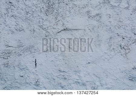 Background of a white stucco coated and painted exterior, rough cast of cement and concrete wall texture