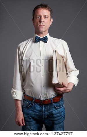 Portrait of a middle age man in a shirt and bowtie