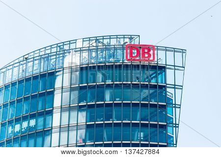 BERLIN, GERMANY - JUNE 22, 2016: Headquarters of Deutsche Bahn. Main German railway operator. Bahn Tower at Potsdamer Platz in Berlin.