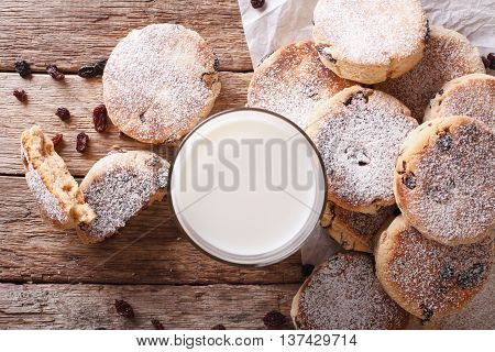 Tasty Welsh Cakes With Raisins And Milk Close-up On The Table. Horizontal Top View