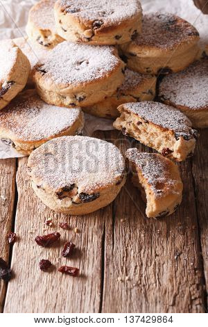 Welsh Cuisine: Cakes With Raisins And Powdered Sugar Close-up. Vertical
