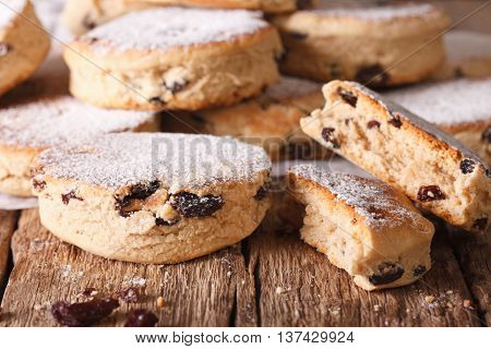 British Biscuits: Welsh Cakes With Raisins And Powdered Sugar Close-up. Horizontal