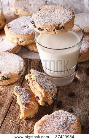 Traditional Welsh Cakes With Raisins And Milk Close-up. Vertical