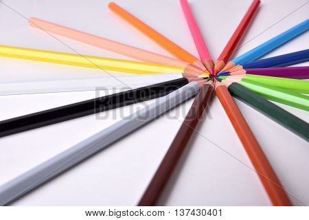 Color Pencils Placed On Circle On White Table Elevated View