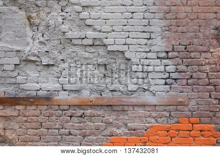 the damaged spotty texture of an old brick wall for a background