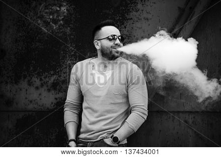 Vaper With Beard In Sunglasses Vaping Outdoor