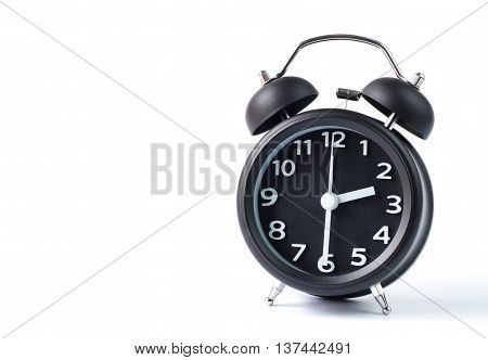 Black double bell alarm clock showing half past two on white background