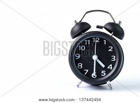 Black double bell alarm clock showing half past four on white background