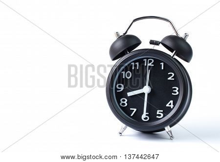 Black double bell alarm clock showing half past eight on white background