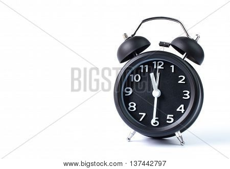 Black double bell alarm clock showing half past eleven on white background