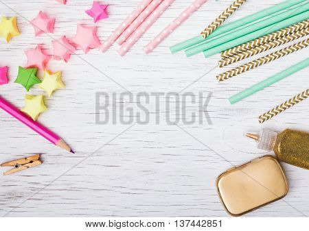 Paper Straws And Stars On White Background