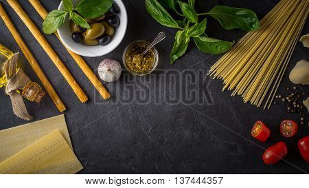 Set of Italian food on the black stone table wide screen