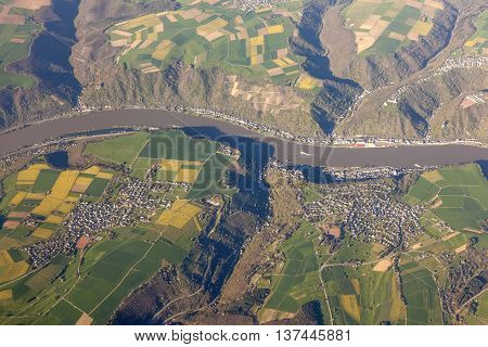 Aerial view over the Rhine River and surrounding villages in Germany