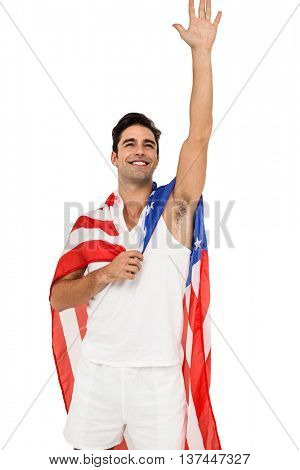 Male athlete posing with american flag wrapped around his body on white background