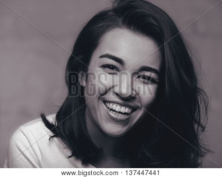 Black and white portrait of a laughing girl