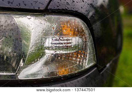 Car lights wet after the rain outdoors