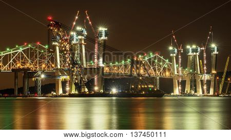 Construction of a new bridge on Hudson River, seen during the night time.